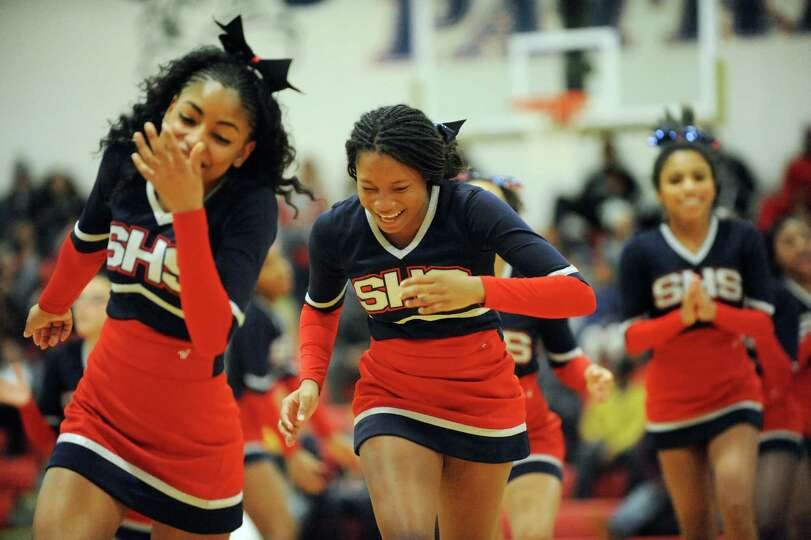 Schenectady cheerleaders laugh after their performance during a break in the basketball action again