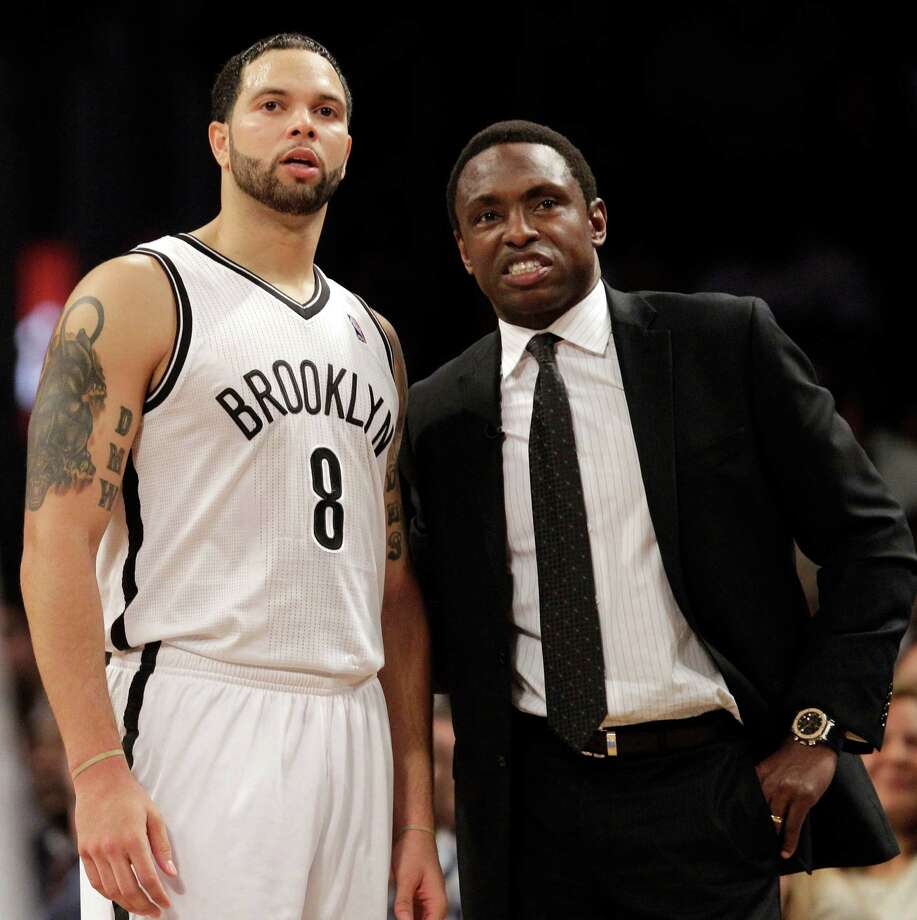 FILE - In this Dec. 11, 2012, file photo, Brooklyn Nets guard Deron Williams (8) and  head coach Avery Johnson chat during the second half of an NBA basketball game against the New York Knicks at the Barclays Center in New York. Johnson was fired on Thursday, Dec. 27, 2012, general manager Billy King announced. (AP Photo/Kathy Willens, File) Photo: Kathy Willens