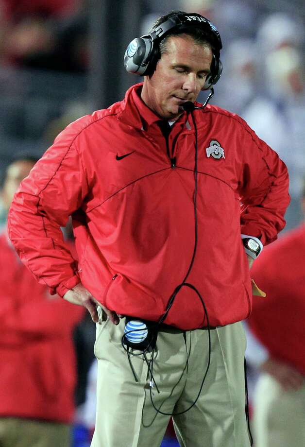 FILE - In this Oct. 27, 2012, file photo, Ohio State head coach Urban Meyer stands on the sideline during the fourth quarter of an NCAA college football game against Penn State in State College, Pa. Meyer is perfectly willing to move on, to cease all the talk about the NCAA, violations and the bowl ban. But that doesn't mean, during a quiet moment, the Ohio State coach still doesn't have a lingering regret _ what might have been. (AP Photo/Gene J. Puskar, File) Photo: Gene J. Puskar
