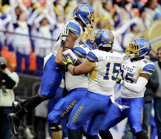San Jose State wide receiver Kyle Nunn (19) is picked up by offensive tackle Jon Meyer (79), tight end Peter Tuitupou (15) and tight end Keenan Brown (85) after his touchdown catch during the first half of the Military Bowl NCAA college football game against Bowling Green at RFK Stadium, Thursday, Dec. 27, 2012, in Washington. (AP Photo/Alex Brandon) Photo: Alex Brandon