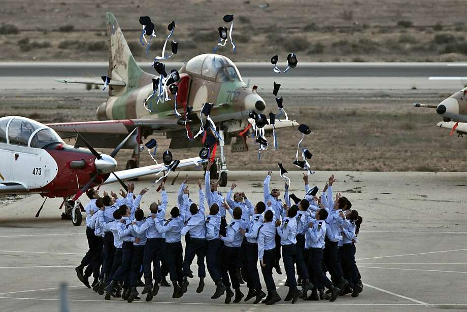 Israeli pilots throw their hats in the air as they celebrate at their graduation ceremony at the Hazerim air force base in the Negev desert, near the southern Israeli city of Beersheva, on December 27, 2012. Photo: Jack Guez, AFP/Getty Images