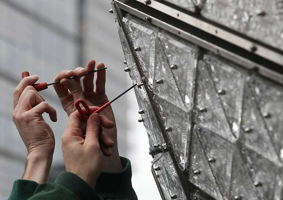 Workers install new Waterford Crystal triangles on the Times Square New Years Eve Ball at a media event on December 27, 2012 in New York City. The ball will once again descend a 141-foot tall flagpole to mark the beginning of 2013. Photo: Mario Tama, Getty Images