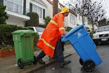 Recology employee, Wayne Belaski, age 47, does recycling and trash pickups along 26th Ave. on December 21, 2012 in San Francisco, Calif. San Francisco residents may have to begin paying for the now free green and blue recycling and compost bins.