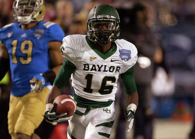 Tevin reese #16 of the Baylor Bears catches the ball ona 55-yard reception scoring a touchdownl in the first half of the game as Zach Hernandez #19 of the UCLA Bruins defends in the Bridgepoint Education Holiday Bowl at Qualcomm Stadium on December 27, 2012 in San Diego, California. Photo: Kent Horner, Getty Images / 2012 Getty Images