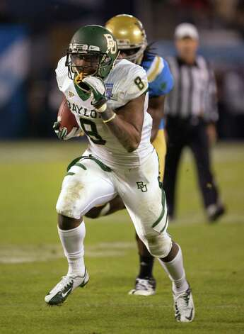 Glasco Martin #8 of the Baylor Bears runs with the ball scoring a touchdown in the first half of the game against the UCLA Bruins in the Bridgepoint Education Holiday Bowl at Qualcomm Stadium on December 27, 2012 in San Diego, California. Photo: Kent Horner, Getty Images / 2012 Getty Images