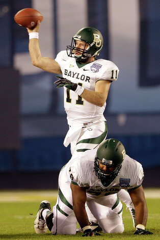 Baylor quarterback Nick Florence throws a pass during the first half of the NCAA college football Holiday Bowl game against UCLA, Thursday Dec. 27, 2012, in San Diego. (AP Photo/Lenny Ignelzi) Photo: Lenny Ignelzi, Associated Press / AP