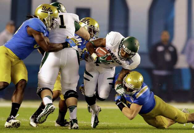 Baylor wide receiver Antwan Goodley breaks through UCLA defense during the first half of the NCAA college football Holiday Bowl game, Thursday, Dec. 27, 2012, in San Diego. (AP Photo/Lenny Ignelzi) Photo: Lenny Ignelzi, Associated Press / AP