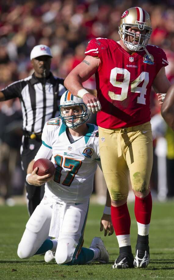 Miami Dolphins quarterback Ryan Tannehill (17) sacked by San Francisco 49ers defensive end Justin Smith (94) in the second quarter of an NFL football game at Candlestick Park on Sunday, Dec. 9, 2012 in San Francisco, Calif.