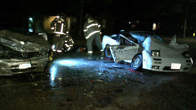 A rain-slick road is believed responsible for a two-car wreck that killed an 18-year-old passenger about 6 p.m. Thursday in New Caney. (Scott Engle / Montgomery County Police Reporter) Photo: Montgomgery County Police Reporter