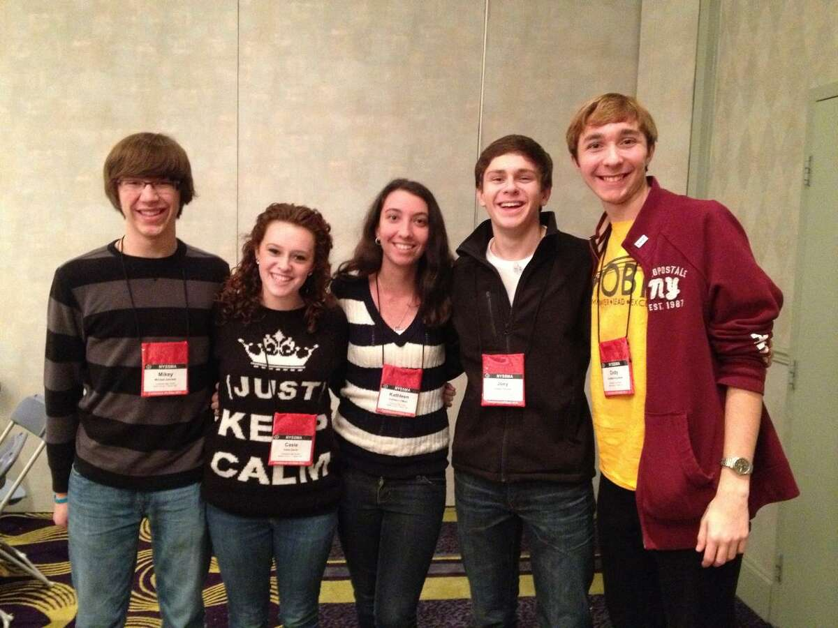 Seven students from the Guilderland High School music department were chosen to participate in a New York State School Music Association All State conference last month in Rochester. From left are singers Michael Janower, Casie Girvin, Kathleen O'Mara, Joey Sipzner and Cody Ingraham. Instrumentalists Hannah Liu and Brendan Snow are not pictured. (Guilderland High School music department)