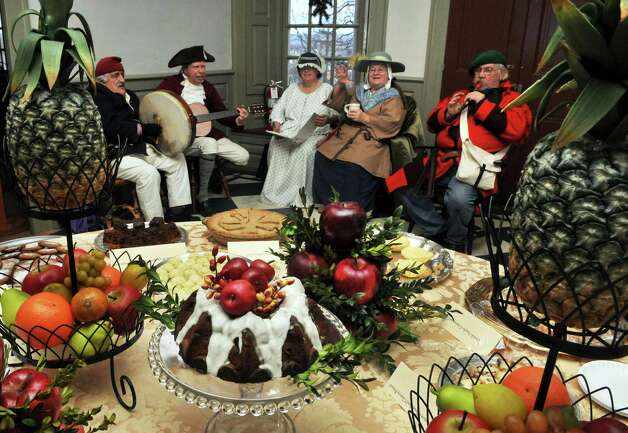 """Rural Felicity"" performs 18th-century tavern music before a table of traditional 18th-century holiday fare during the annual Twelfth Night celebration at the Schuyler Mansion State Historic Site in Albany Saturday Jan. 7, 2011.   (John Carl D'Annibale / Times Union) Photo: John Carl D'Annibale / 10016013A"