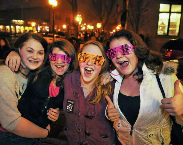 "Friends (from left) Chelsea Reynolds,13, Shannon Haley,13, Destiny Lane, 14, and Marlena Zygadlo,13, all of Saratoga Springs celebrate First Night Saratoga 2012 sporting ""2012 glasses""  on Broadway in  Saratoga Springs Saturday Dec. 31, 2011.   (John Carl D'Annibale / Times Union) Photo: John Carl D'Annibale / 00015906A"