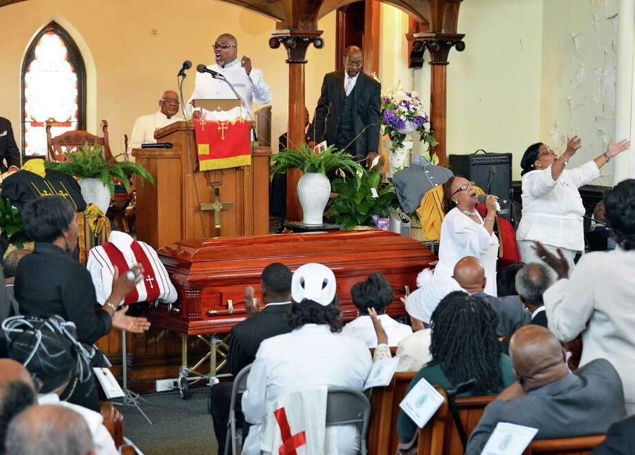 "Sis. Maggie Lee Terrell, at right with microphone, sings ""I'm On My Way to Heaven"" during funeral services for Pastor Emeritus Willis F. Bruton at Sweet Pilgrim Missionary Baptist Church in Albany Thursday June 28, 2012.  (John Carl D'Annibale / Times Union) Photo: John Carl D'Annibale, Albany Times Union / 00018231A"