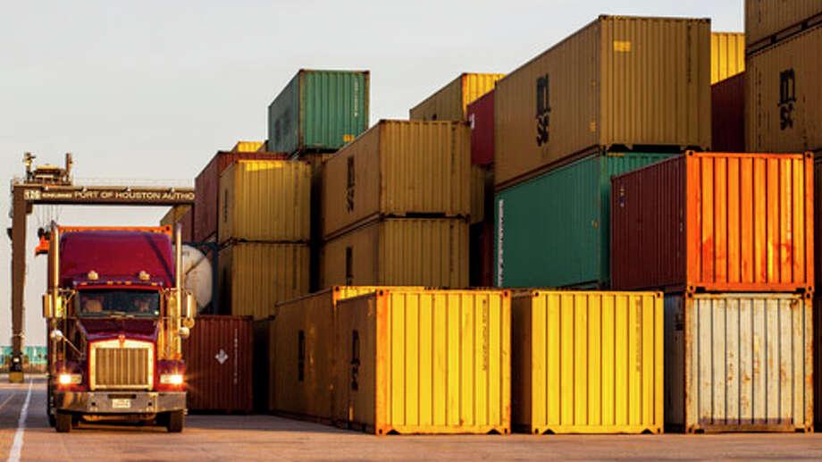 Cargo moves through the Port of Houston Dec. 26, 2012 in Houston. Photo: Eric Kayne, . / © 2012 Eric Kayne