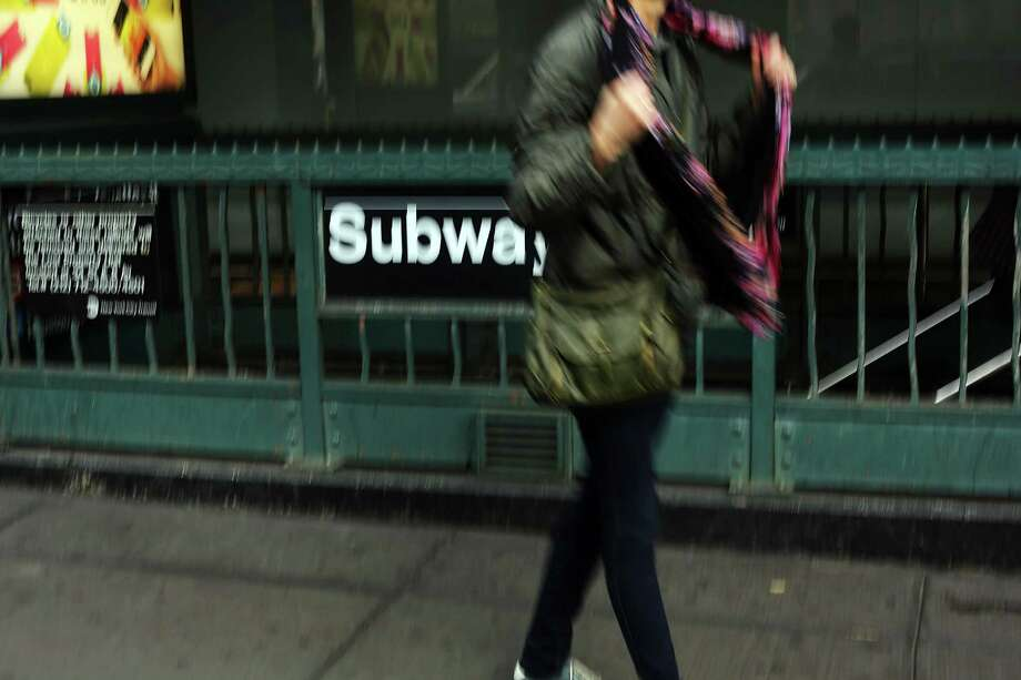 NEW YORK, NY - DECEMBER 05:  A pedestrian passes a subway stop in Manhattan two days after a man was pushed to his death in front of a train on December 5, 2012 in New York City. The incident was caught by a photographer and has since raised questions as to why someone didn't help the man before the train struck him. The New York City subway system, with 468 stations in operation, is the most extensive public transportation system in the world. It is also one of the world's oldest public transit systems, with the first underground line of the subway opening on October 27, 1904. Photo: Spencer Platt, Getty Images / 2012 Getty Images