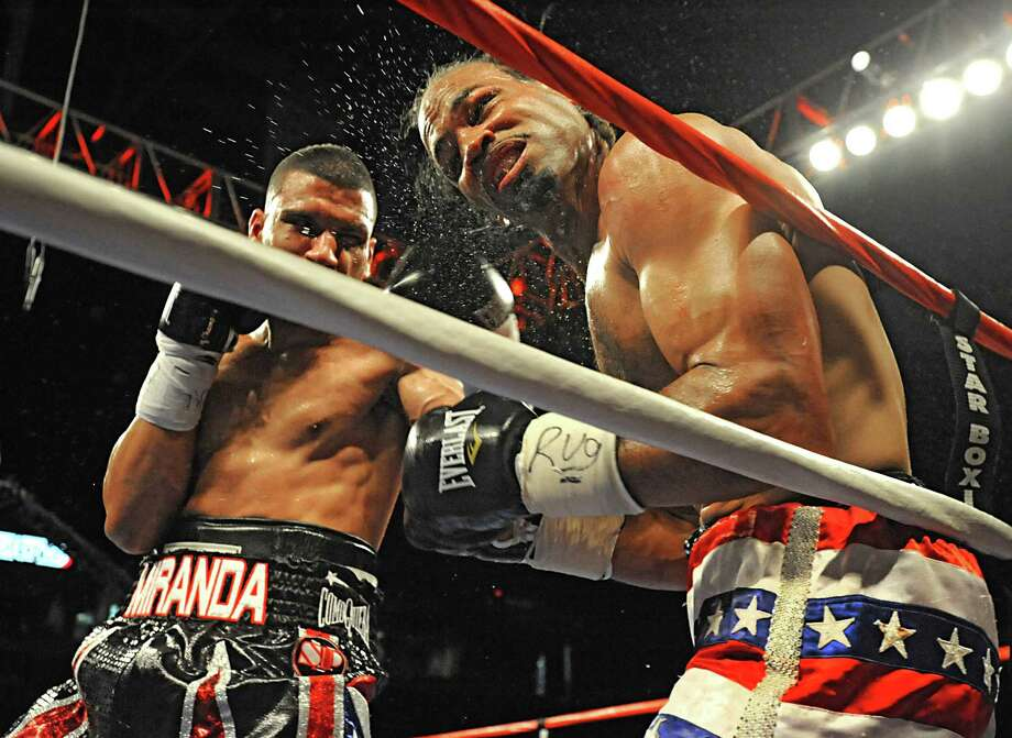 From left, Vincent Miranda punches David Telesco with a hard left as they box during the ESPN2's Friday Night Fights at the Times Union Center on Friday, May 18, 2012 in Albany, N.Y.  (Lori Van Buren / Times Union) Photo: Lori Van Buren, Albany Times Union / 00017716A