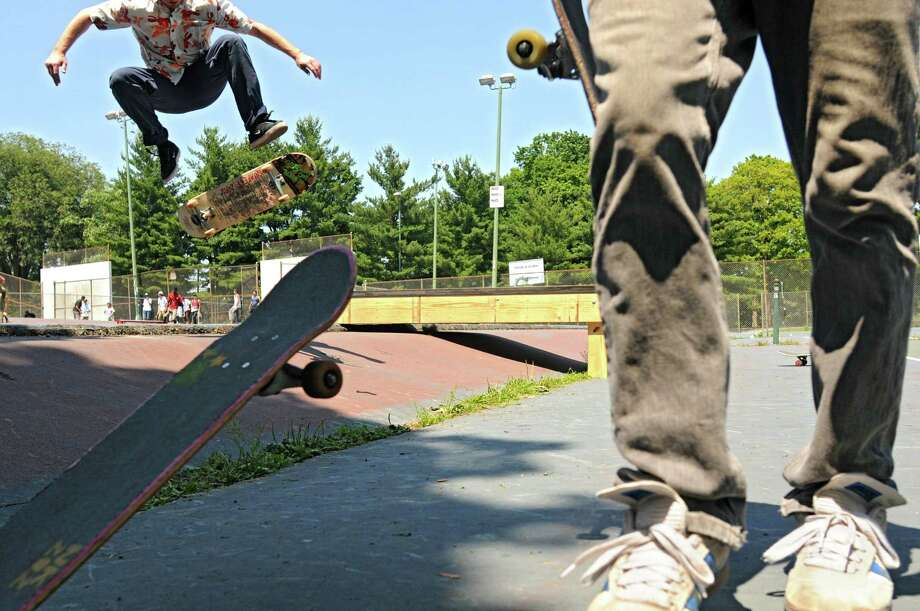 Skateboarders perform tricks during a skateboard contest in Washington Park Thursday, June 21, 2012 in Albany, N.Y. Today is national skateboard day. (Lori Van Buren / Times Union) Photo: Lori Van Buren, Albany Times Union / 00018198A