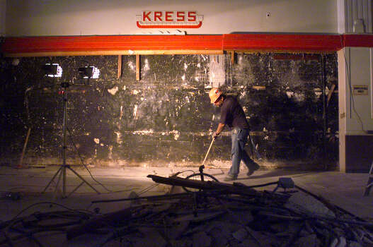 A worker cleans up some of the demolition mess at the Kress Building years ago. (SAN ANTONIO EXPRESS-NEWS) Photo: TOM REEL