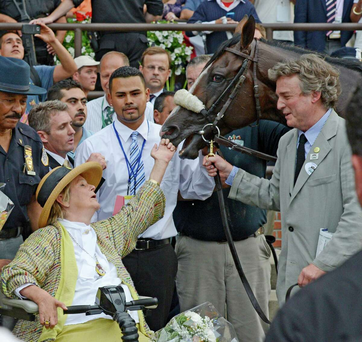 Union Rags gets a tap on the nose from owner Phyllis Wyeth after winning the 144th running of The Belmont Stakes at Belmont Park in Elmont, N.Y. June 9, 2012.