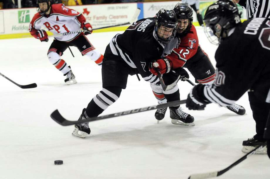 High-level hockey (No. 7) abounds in the Capital Region. Union's Josh Jooris (7), center, keeps RPI's Johnny Rogic (12) away from the puck during Game 2 of the ECAC hockey quarterfinals against RPI on Saturday, March 10, 2012, at Union College in Schenectady, N.Y. Union wins 4-2. (Cindy Schultz / Times Union) Photo: Cindy Schultz, Albany Times Union / 00016700B