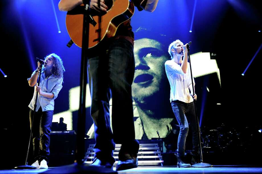 "Phillip Phillips, center, performs with Deandre Brackensick, left, and Colton Dixon during the ""American Idol Live Tour 2012"" on Thursday, Aug. 30, 2012, at Times Union Center in Albany, N.Y. (Cindy Schultz / Times Union) Photo: Cindy Schultz, Albany Times Union / 00018952A"