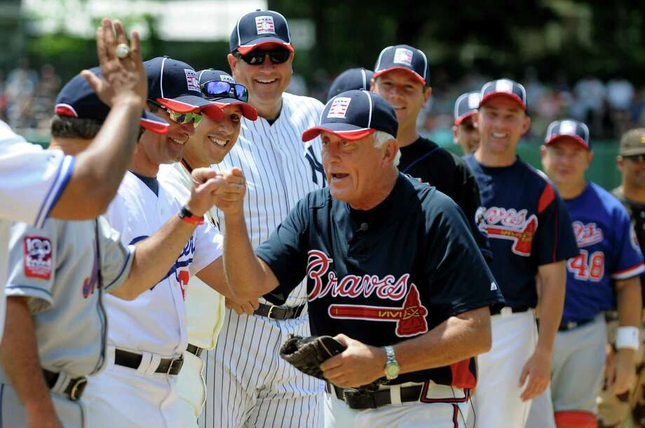 Hall of Fame pitcher Phil Niekro, center, greets his teammates for the annual Hall of Fame Classic old-timers baseball game on Saturday, June 16, 2012, at Double Day Field in Cooperstown, N.Y. (Cindy Schultz / Times Union) Photo: Cindy Schultz, Albany Times Union / 00018089A