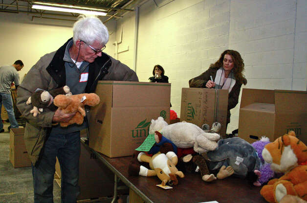 Volunteers sort stuffed animals at a storage warehouse for goods donated in the aftermath of the Dec. 14  shooting at Sandy Hook Elementary School. Photo: Kristen V. Brown / The News-Times