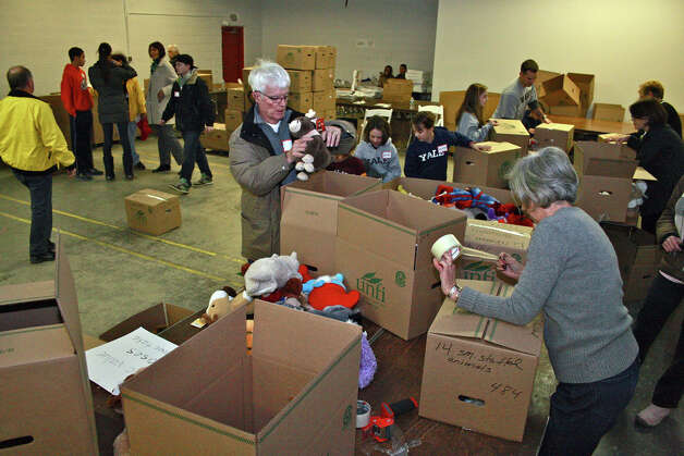 Volunteers sort stuffed animals at a storage warehouse for goods donated in the aftermath of the Dec. 14 shooting at Sandy Hook Elementary School. Photo: Kristen V. Brown, David W. Harple / The News-Times