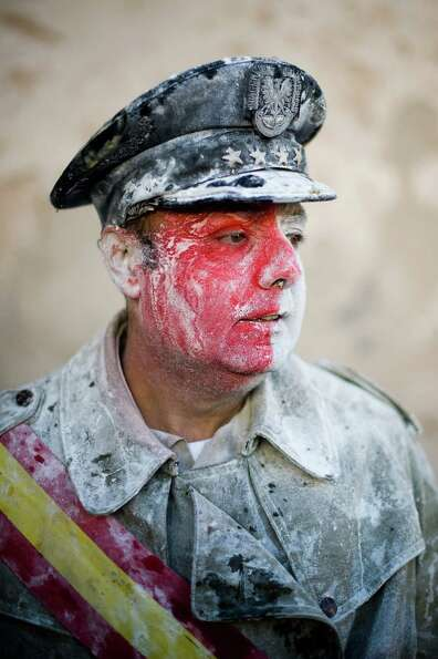 Flour mixes with face paint. (Photo by David Ramos/Getty Images)