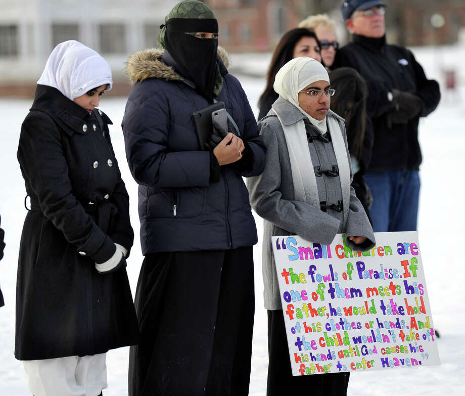 From left, Naveera Karim, Ayesha Akhtar and Anwar Abdulrehman, members of the Islamic Society of Western Connecticut, attend a prayer vigil to remember the victims of the Sandy Hook shootings. The Newtown Interfaith Clergy Association held an interfaith prayer vigil Friday morning, Dec. 28, 2012, on the grounds of Fairfield Hills in Newtown. Friday morning marked two weeks since a gunman killed 20 children and six educators at the Sandy Hook Elementary School. Photo: Carol Kaliff / The News-Times