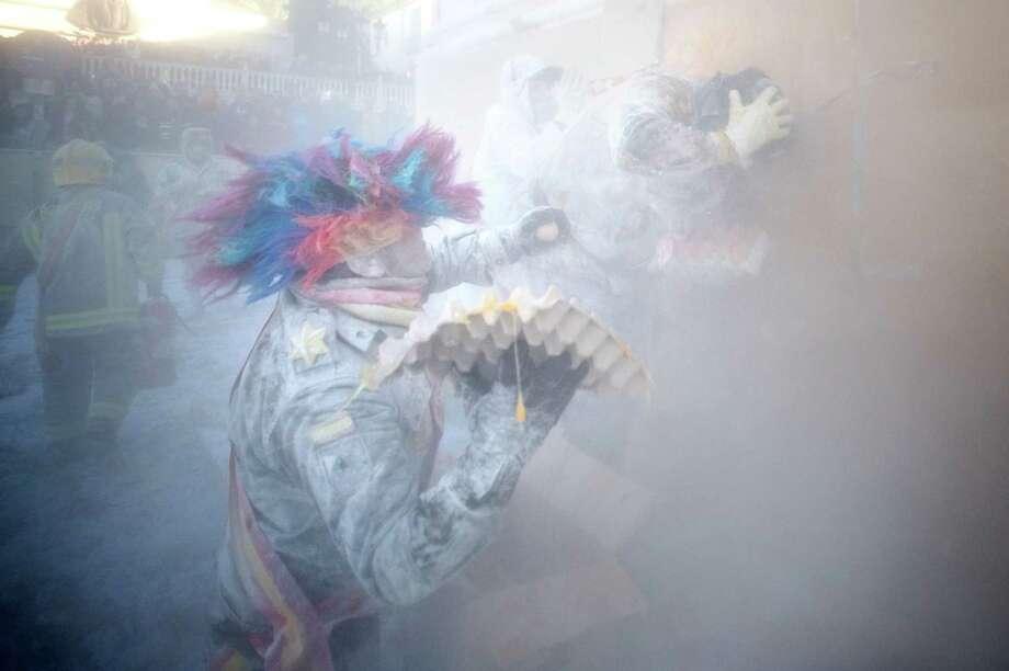 Then the flour flies. (Photo by David Ramos/Getty Images) Photo: David Ramos, Ap/getty / 2012 Getty Images