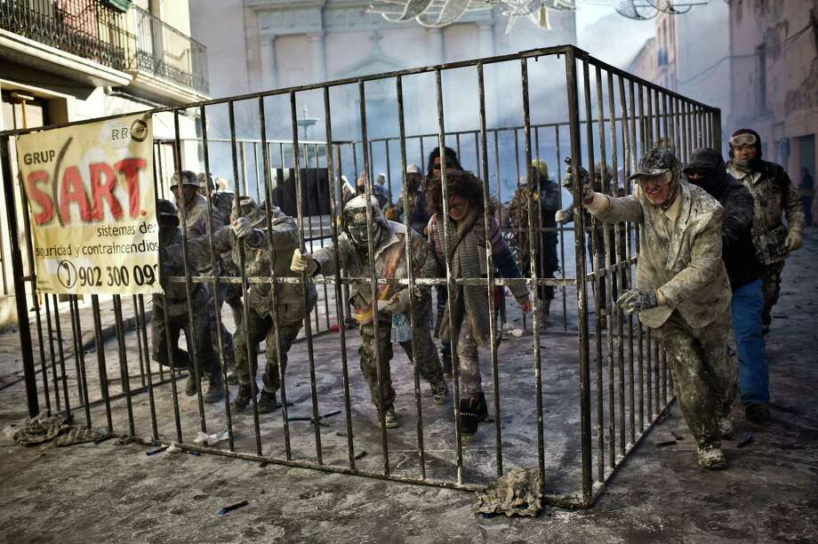 The festival involves jail. If you don't pay revelers a fine, you go to jail. (Photo by David Ramos/Getty Images) Photo: David Ramos, Ap/getty / 2012 Getty Images