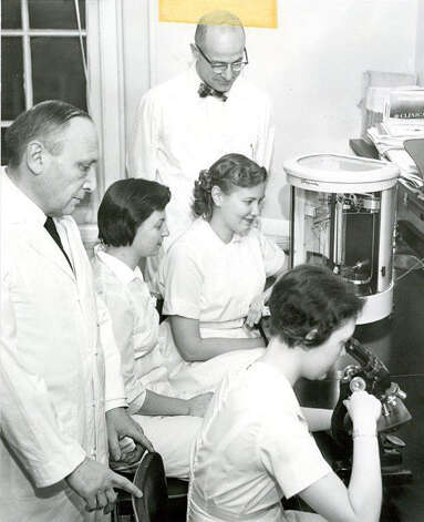 John C. Creasy in the lab, pictured in rear, standing. Photo provided by the Western Connecticut Health Network. Photo: Contributed Photo