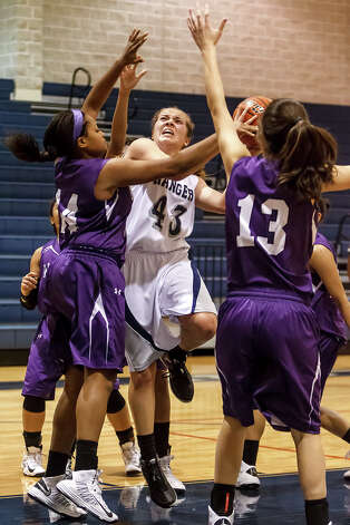 Smithson Valley's Liz Cathcart (center) drives to the basket between Warren's Adrienne Lightfoot (left) and Meghan Cantu during the second half of their game at Smithson Valley on Dec. 18, 2012.  The Lady Rangers won the game 35-34 on a last second shot.  Photo by Marvin Pfeiffer / Prime Time Newspapers Photo: MARVIN PFEIFFER, Express-News / Prime Time Newspapers 2012