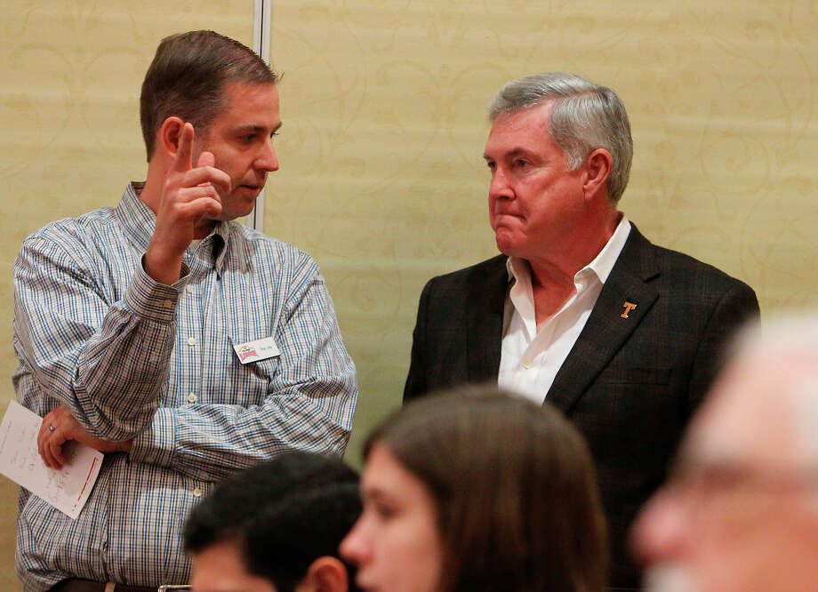 Texas head coach Mack Brown (center) converses with Valero Alamo Bowl's Rick Hill before a press conference at Marriott Rivercenter on Friday, Dec. 28, 2012. Two University of Texas players were accused of sexual assault and had been suspended by coach Brown for violating team rules. He did not answer any questions regarding the allegations or the two players' identities. Photo: Kin Man Hui, San Antonio Express-News / © 2012 San Antonio Express-News