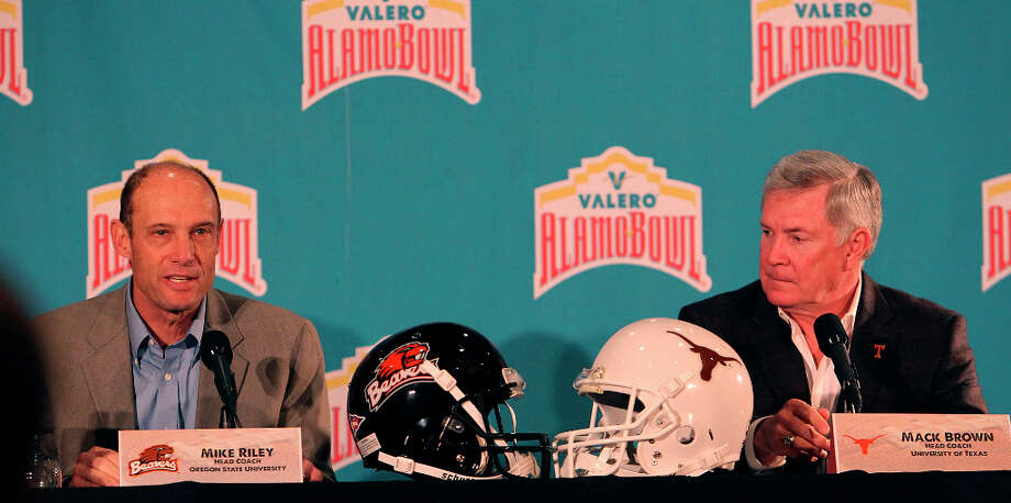 Texas head coach Mack Brown (right) and Oregon State head coach Mike Riley field questions on the eve of the Valero AlamoBowl game at Marriott Rivercenter on Friday, Dec. 28, 2012. Two University of Texas players were accused of sexual assault and had been suspended by coach Brown for violating team rules. He did not answer any questions regarding the allegations or the two players' identities. Photo: Kin Man Hui, San Antonio Express-News / © 2012 San Antonio Express-News