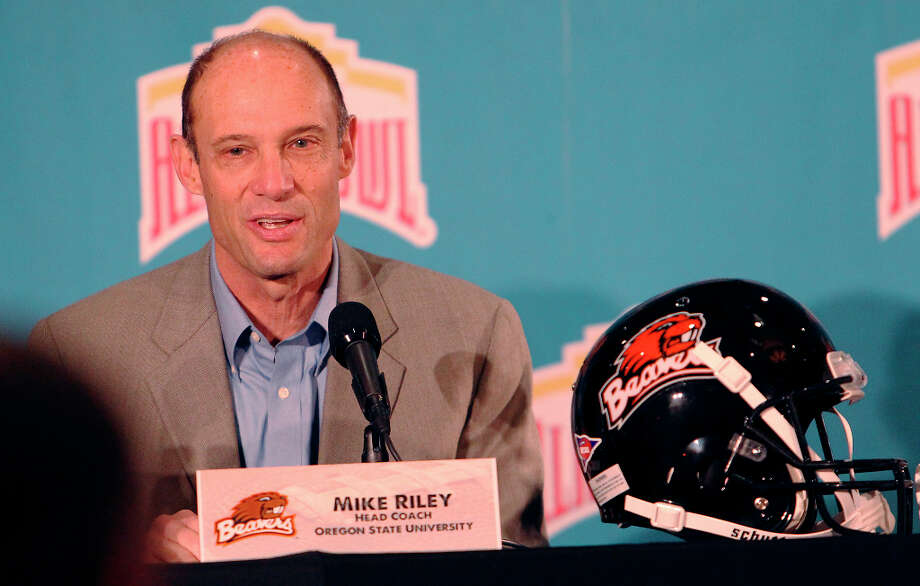 Oregon State head coach Mike Riley field questions on the eve of the Valero AlamoBowl game at Marriott Rivercenter on Friday, Dec. 28, 2012. Two University of Texas players were accused of sexual assault and had been suspended for violating team rules. Texas coach Mack Brown did not answer any questions regarding the allegations or the two players' identities. Photo: Kin Man Hui, San Antonio Express-News / © 2012 San Antonio Express-News