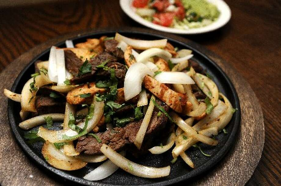 Beef and chicken fajitas. Randy Edwards/cat5