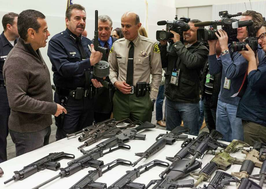 A recent Gun Buyback event in Los Angeles proved to be a big success as people throughout the nation, including our readers, debate the merits of a new gun control policy. Photo: Damian Dovarganes, Associated Press / AP