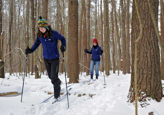 Katherine Martin, left, 17, of Schenectady enjoys the new snow by cross country skiing with her mother Janice Martin at Saratoga Spa State Park  on Friday Dec. 28, 2012 in Saratoga Springs, N.Y. (Lori Van Buren / Times Union) Photo: Lori Van Buren
