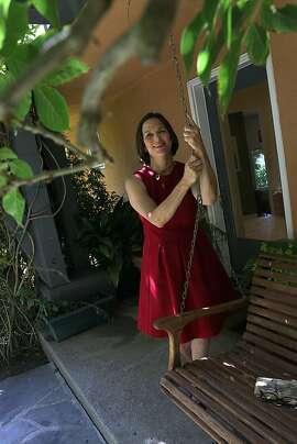 Berkleyside editor Frances Dinkelspiel at home in Berkeley, Calif., standing next to her porch swing on Wednesday, August  8, 2012.