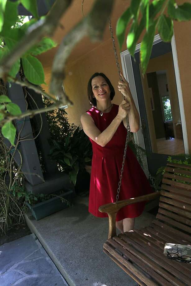 Berkleyside editor Frances Dinkelspiel at home in Berkeley, Calif., standing next to her porch swing on Wednesday, August  8, 2012. Photo: Liz Hafalia, The Chronicle