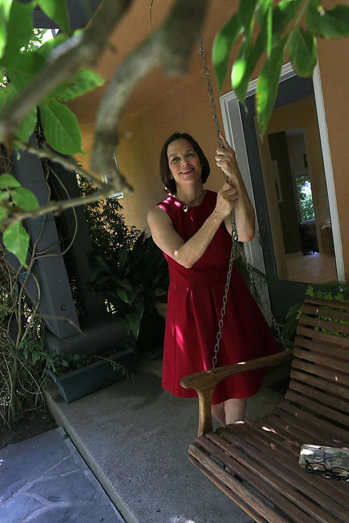 Berkleyside editor Frances Dinkelspiel at home in Berkeley, Calif., standing next to her porch swing on Wednesday, August 8, 2012.