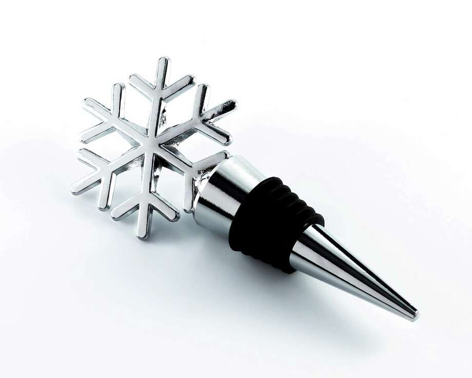 A snowflake-shaped wine bottle topper  makes a good holiday party favor. Photo: Associated Press / Beau-coup.com