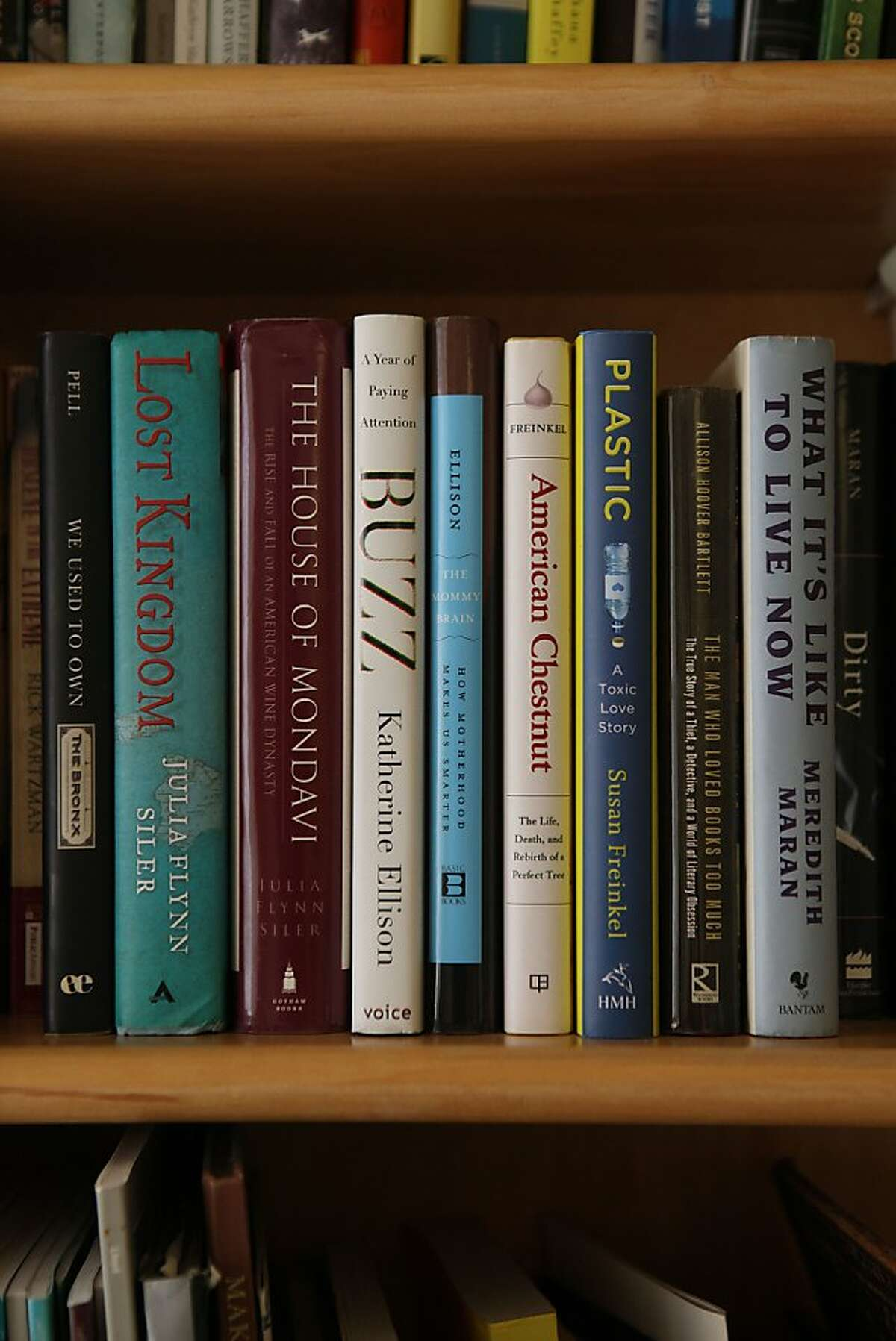 Berkleyside editor Frances Dinkelspiel shows a shelf of books written by friends in Berkeley, Calif., on Wednesday, August 8, 2012.