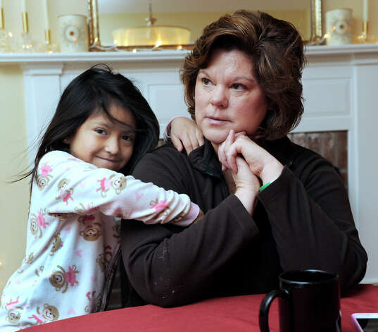 Therese Lestik, with her daughter, Eva, 5, talks about the Dec. 14, 2012 Sandy Hook Elementary School shooting. Eva is a kindergartner at the school in Newtown, Conn. Photo: Carol Kaliff / The News-Times