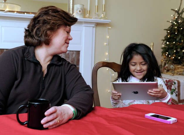 Therese Lestik, with her daughter, Eva, 5, talks about the Dec 14, 2012 Sandy Hook Elementary School shootings, in their Newtown, Conn. home on Tuesday, Dec. 26, 2012. Eva is a kindergartner at Sandy Hook Elementary School. Photo: Carol Kaliff / The News-Times