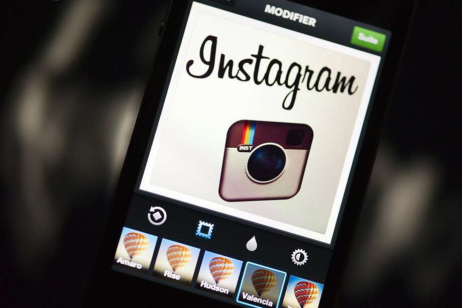 The Instagram logo is displayed on a smartphone on December 20, 2012 in Paris. Instagram backed down on December 18, 2012 from a planned policy change that appeared to clear the way for the mobile photo sharing service to sell pictures without compensation, after users cried foul. Changes to the Instagram privacy policy and terms of service set to take effect January 16 had included wording that appeared to allow people's pictures to be used by advertisers at Instagram or Facebook worldwide, royalty-free.   AFP PHOTO / LIONEL BONAVENTURELIONEL BONAVENTURE/AFP/Getty Images Photo: Lionel Bonaventure, AFP/Getty Images