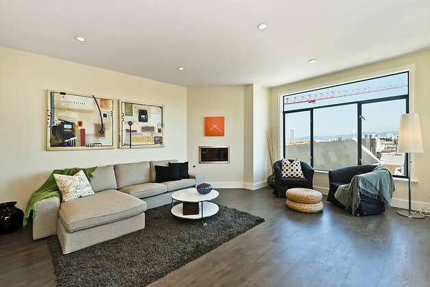 The living room is flooded with natural light during the day. Photo: Vanguard Properties/SF