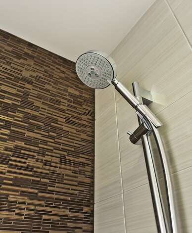 European-style glass shower doors and Grohe fixtures are found in the bathroom. Photo: Vanguard Properties/SF